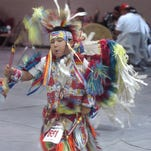 Riley Spoon Hunter, 7, of Badger Creek, dances during the grand entry at Heart Butte Society Celebration in 2009. This year's celebration takes place Aug. 6-9.