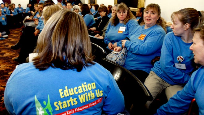 Early educators wear blue shirts at the Statehouse in Montpelier in 2011. Questions arose Monday about what effect a U.S. Supreme Court ruling regarding union fees would have on the Vermont group.