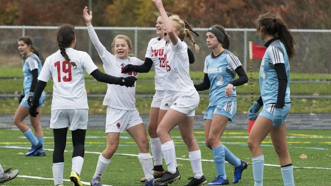 CVU celebrates a late goal during the girls high school playoff game between the Champlain Valley Union Redhawks and the South Burlington Rebels at South Burlington High School on Saturday afternoon October 29, 2016 in South Burlington.