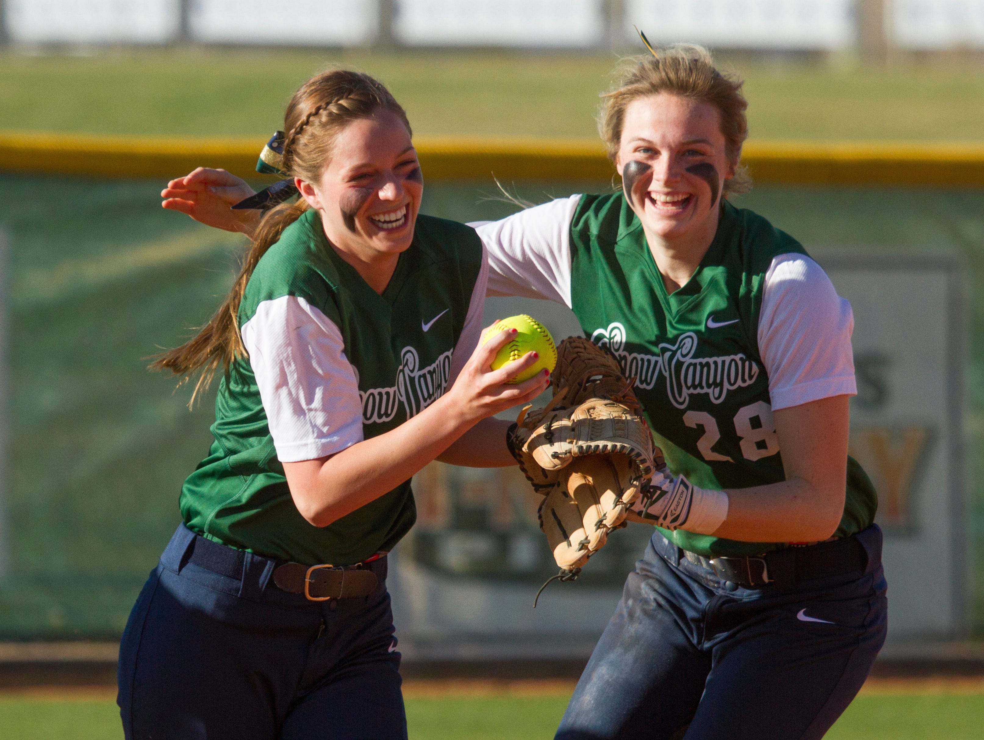 Snow Canyon left fielder Kaitlyn Flowers celebrates with teammates after making a catch for an out against Sky View Thursday, March 10, 2016.