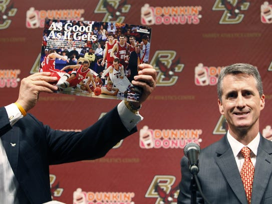 Boston College athletic director Gene DeFilippo, left,