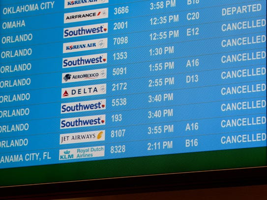Information monitors show cancellations for many flights