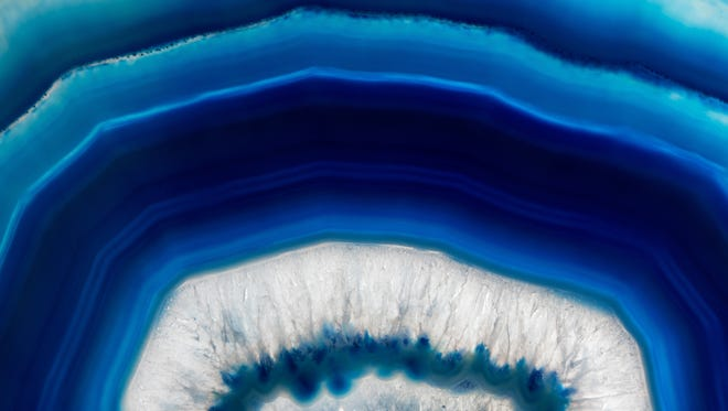 Slice background  of a  blue agate crystal