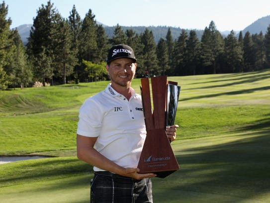 Chris Stroud poses with the trophy after winning the