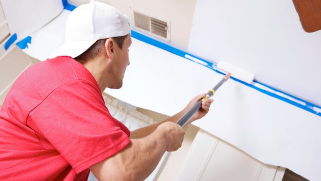 Painting the ceiling can be a mess, so proper masking of the floor is one of the most important parts of the job.