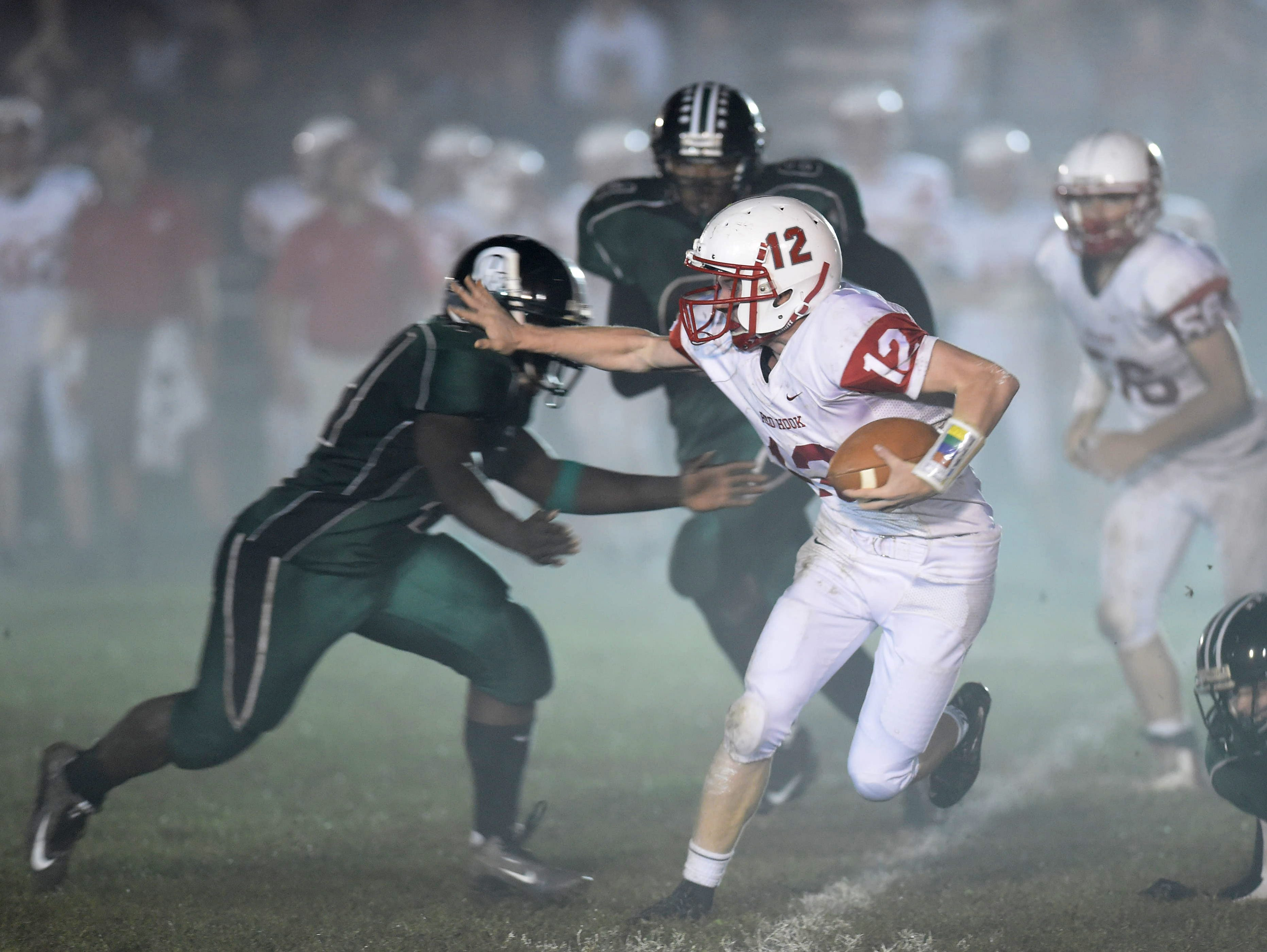 Red Hook High School's Nick Morrissey evades Spackenkill defenders during their Oct. 9 game.