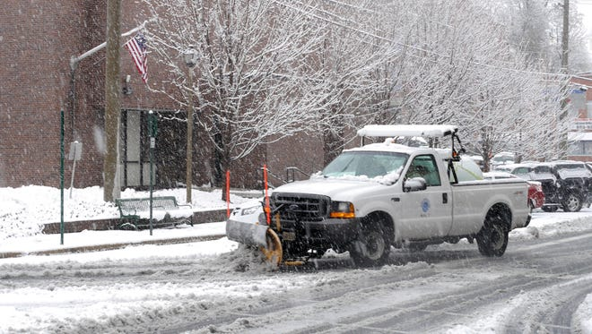 A City of Staunton public works truck plows snow at West Frederick Street and North Central Avenue November 26, 2014.