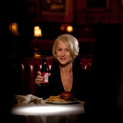 This photo provided by Anheuser-Busch shows actress Helen Mirren in a Budweiser ad for Super Bowl 50. In the ad, Mirren delivers a lecture about drunk driving and why it?s a terrible idea. (Anheuser-Busch via AP)
