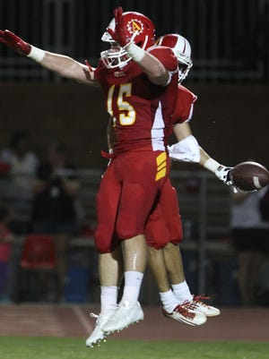 Palm Desert's Tate Oligney (15) celebrates Jacob Castelli's touchdown in the first quarter on Sept. 6, 2013 against Shadow Hills in Palm Desert. The Aztecs won their first meeting with the Knights 55-20 before falling 34-14 in 2014 on the road.