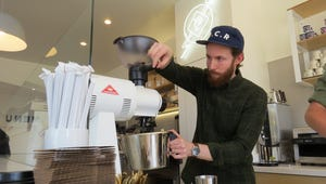 In this 2017 photo, Blake Ulrich grinds beans behind the counter at Prospect Coffee Roasters' coffee bar on Laurel Street in downtown Ventura. National Coffee Day will be celebrated this year on Wednesday, Sept. 29, 2021.