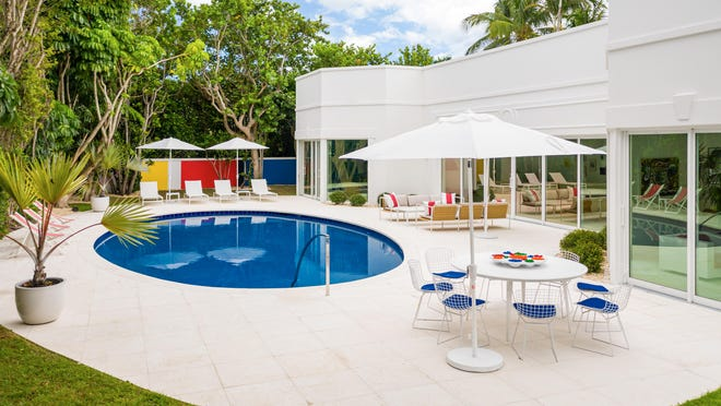 The pool area is the focal point for many of the rooms in a house renovated by fashion designer Lisa Perry at 3 Via Los Incas in Palm Beach. The ocean-block house just sold for $9.1 million, according the local multiple listing service. The house was Perry's first renovation project designed specifically for resale.