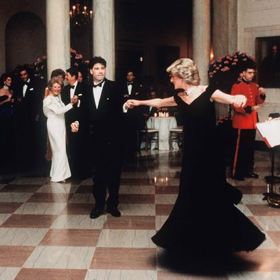 Princess Diana, watched by President Reagan and wife