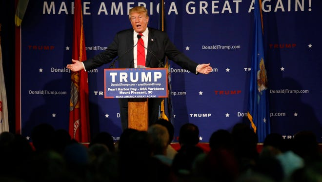 In this Dec. 7, 2015, photo, Republican presidential candidate Donald Trump speaks during a rally coinciding with Pearl Harbor Day at Patriots Point aboard the aircraft carrier USS Yorktown in Mount Pleasant, S.C. Promising to tear up trade deals and tax imports, Trump taps into voter fears of foreign competition long unaddressed by the political system. But analysts say his ideas are misguided.