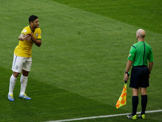 CORRECTS ID TO HULK - Brazil's Hulk argues with the assistant referee after his goal was disallowed due to a handball during the World Cup round of 16 soccer match between Brazil and Chile at the Mineirao Stadium in Belo Horizonte, Brazil, Saturday, June 28, 2014. (AP Photo/Hassan Ammar)