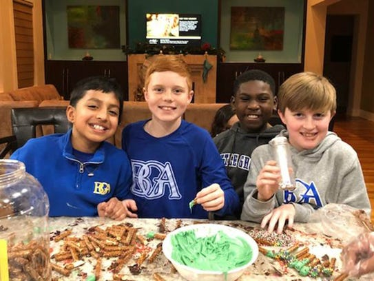 Eyan Patel (the organizer), Bode Robertson, elGee Webster and Jack Biggs raised more than $650 with their cookie stand at Battle Ground Academy for the Penny Drive.