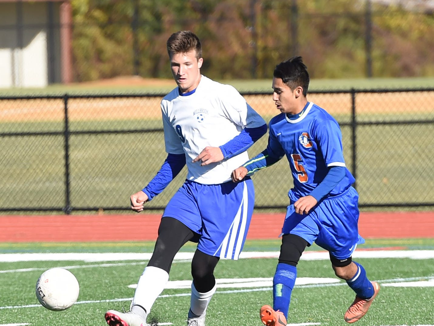 Millbrook's Alex Censi passes the ball away from Chester's Christian Lopez during Monday's sectional semifinal game.