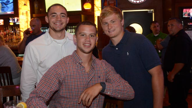 Roberson's Braxton Davidson, center, with North Henderson's Zack Gahagan, left, and Rams teammate Connor Lind.