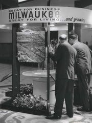 A fountain is the focal point of a new $10,000 promotional display for Milwaukee in this July 27, 1966, photo.  Ald. Martin E. Schreiber (left) and Mayor Henry Maier viewed the display after it was unveiled at City Hall.