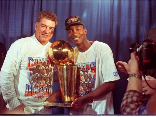 Pistons coach Chuck Daly, left, and guard Isiah Thomas hold the Larry O'Brien championship trophy June 14, 1990, after defeating the Trail Blazers in Game 5 of the NBA finals.