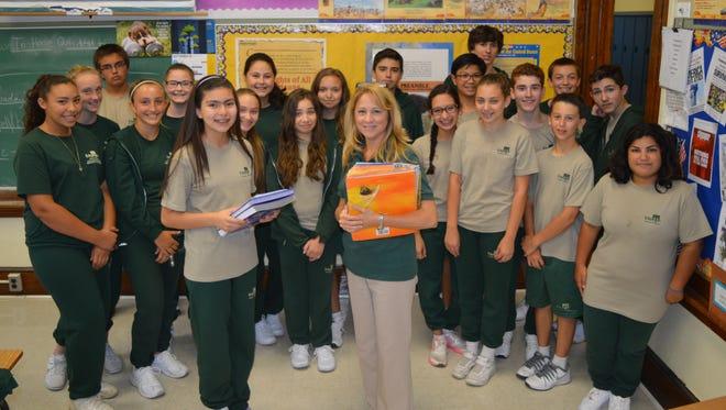 Exchange student Victoria Martinez (front, left) with teacher Stephanie Zappariello at Edgarton Christian Academy.