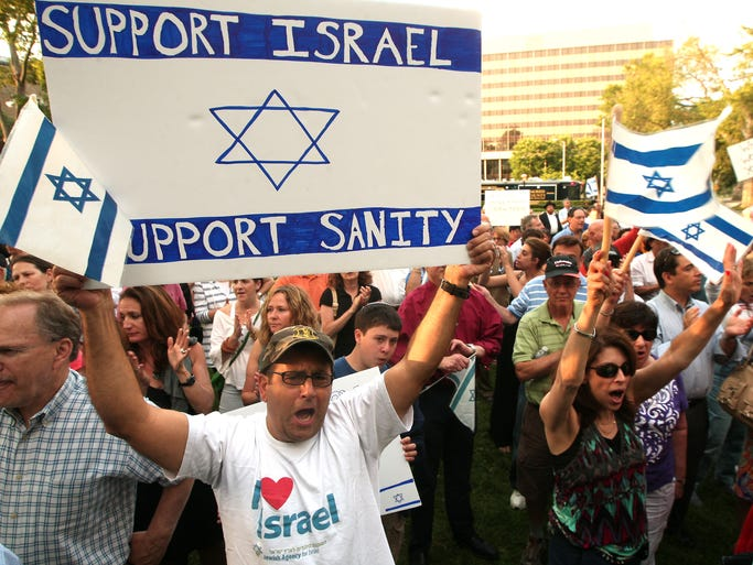 Gregg Russo, l, of Randolph chants with hundred of other supporters of Israel as the Jewish Federation of Greater Metrowest NJ holds an Israel Solidarity Rally on the Morristown Green. August 7, 2014, Morristown, NJ. Photo by Bob Karp