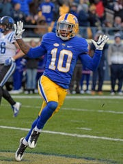 FILE - In this Nov. 19, 2016, file photo, Pittsburgh wide receiver Quadree Henderson (10) celebrates a touchdown during an NCAA college football game against Duke,  in Pittsburgh.  Quadree Henderson was selected to The AP All-Atlantic Coast Conference first team, Wednesday, Dec. 7, 2016.  (AP Photo/Fred Vuich, File)