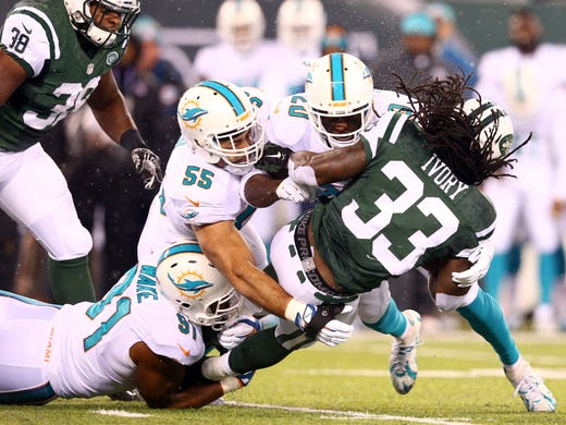 8cc48002e New York Jets running back Chris Ivory (33) is tackled