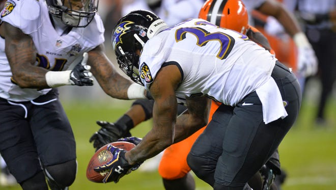 Ravens SS Will Hill (33) picks up the ball and runs for the game-winning touchdown Monday night.