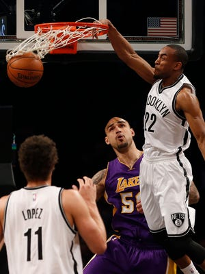 Brooklyn Nets rookie guard Markel Brown (22) dunks against Los Angeles Lakers center Robert Sacre (50) on Sunday.