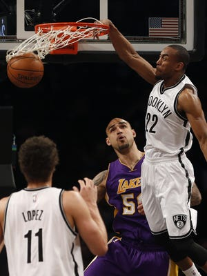 Brooklyn Nets rookie guard Markel Brown (22) throws down a dunk against Los Angeles Lakers center Robert Sacre (50) during a home game on March 29. Brown scored a career-high 17 points in the Nets' 107-99 win.