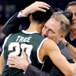 MSU head coach Tom Izzo hugs senior guard Travis Trice after MSU's 60-54 victory over Virginia in their NCAA game in Charlotte, NC. Sunday March 22, 2015.