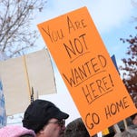 A sign is displayed as part of the demonstrations outside the Harney County Courthouse in Burns, Ore., Monday, Feb. 1, 2016.
