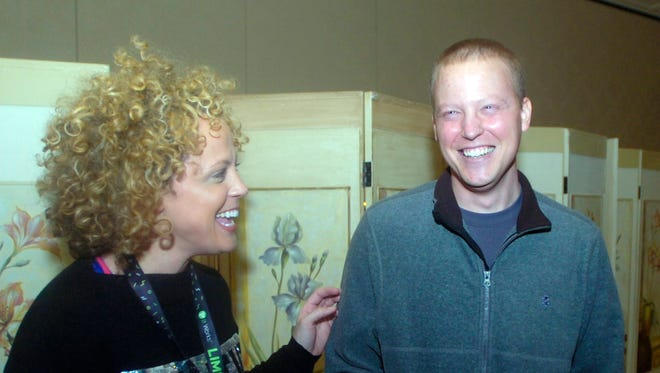 Ryan Humphrey and Amie Oliveira from Troy share a laugh before the fundraiser started at the Townsend on Monday. Humphrey, a Troy Athens graduate, is battling a rare form of cancer called angiosarcoma.
