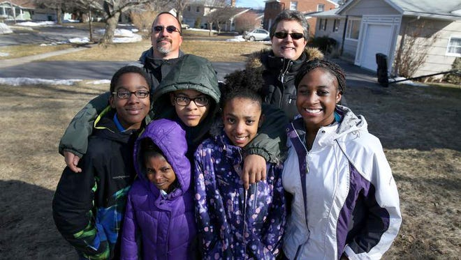 John and Stacy D'Armiento with their five adopted children William, 11 (L-R), Zoey, 8, Sean 13, Johanna, 10, Michaela, 18. William, Zoey and Johanna received winter coats as part of Make a Difference Day.