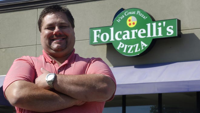 Scott Cardwell stands at one of three new Folcarelli's Pizza shops he is opening in Montgomery, Ala. on Thursday July 3, 2014.