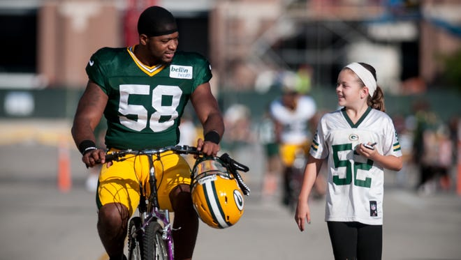 Green Bay Packers linebacker Sam Barrington rides to training camp practice at Ray Nitschke Field.