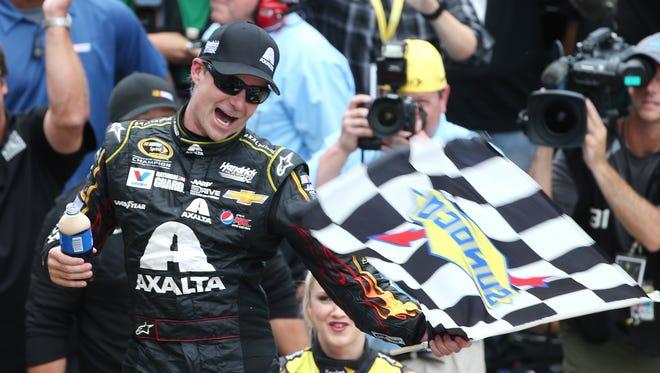 Jeff Gordon celebrates his fifth Brickyard 400 win at the Indianapolis Motor Speedway  Sunday, July 27, 2014.