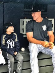 Luca Iacono, of Middletown, chats with Aaron Judge
