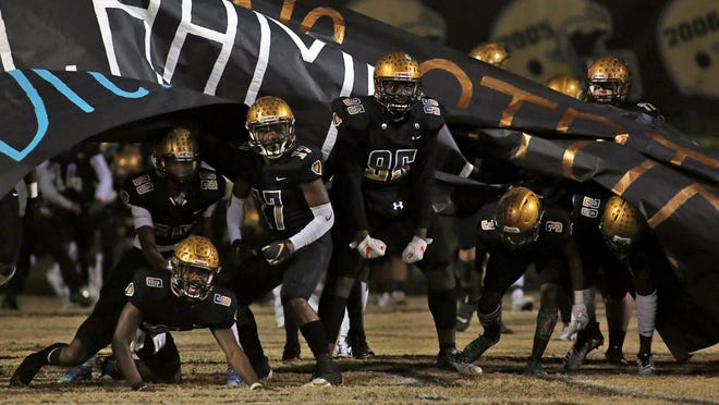 Shelby football players prepare to take the field prior to last December's West 3A final against Burns.