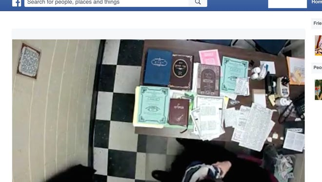 Facebook video screen shot of school principal and a child that police are investigating.