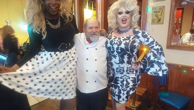 Mark Smith, owner and chef of Tortilla Press, poses with drag queens at the restaurant's drag brunch.