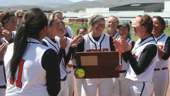 The Fernley High School softball team stands with the state championship trophy they won over Fallon Saturday.
