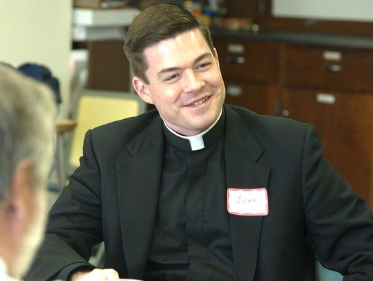 The Rev. John Fleckenstein from St. Phillip Catholic