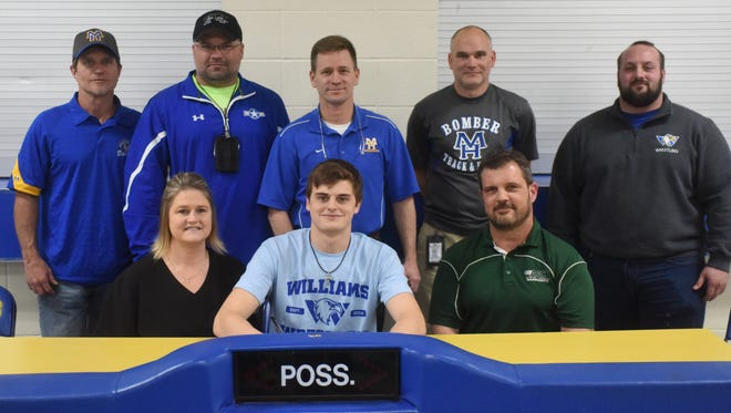 Mountain Home's Read Parker signed Thursday to wrestle at Williams Baptist College. Shown with Parker at his signing ceremony are: first row, his parents, Buck and Nikki Wood; second row, from left, Parker's MHHS and youth wrestling coaches, Ted Morgavan, Scott Callies, Travis Alexander, Robert Blades, and Williams Baptist assistant wrestling coach Daniel Capp.