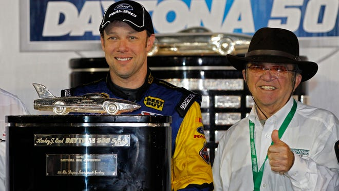 Matt Kenseth and car owner Jack Roush pose in victory lane after Kenseth won the Daytona 500 for the second time.
