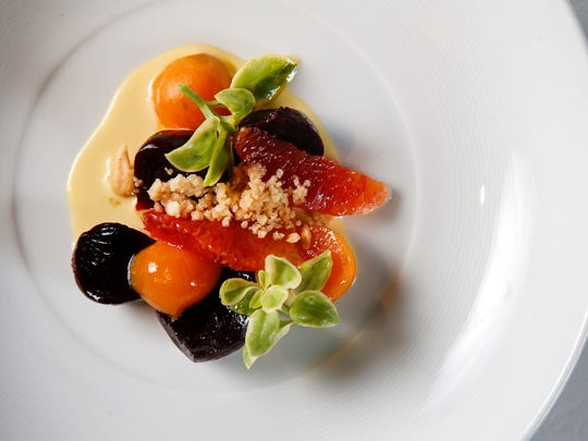 The beet salad, featuring pickled beets, cashew, blood orange and emerald lettuce, pictured, Monday, March 6, 2017, at Orchids at Palm Court restaurant in Cincinnati.