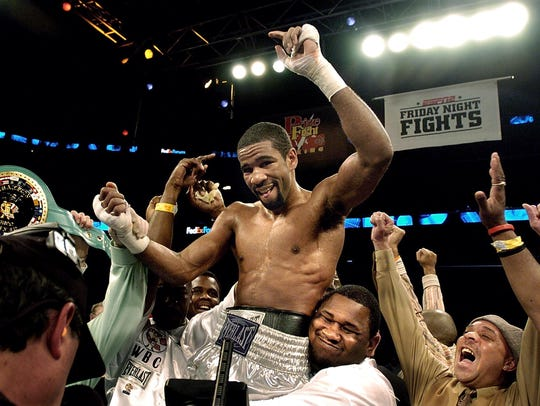 Lamont Peterson, top, celebrates his WBC USA Junior Welterweight title after defeating Jose Moreno at the FedEx Forum on Feb. 17, 2006.