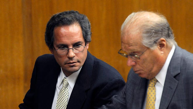 Thomas Rica, a former employee of the Village of Ridgewood, N.J., sits next to his attorney, Robert. L. Galantucci, at his sentencing Wednesday, July 9, 2014, in Hackensack, N.J. Rica, who admitted stealing $460,000 in quarters over two years, has been spared a prison term. A judge instead sentenced Rica to five years of probation. (AP Photo/Northjersey.com, Carmine Galasso, Pool)