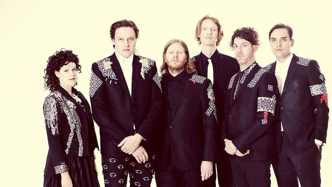 Arcade Fire's Will Butler (far right) says the band's current tour is fun, but 'remains an insane amount of work.'