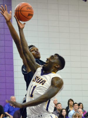 LC's Anthony Gaines Jr. (35, back) tries to block LSUA's Jason Hawthorne's (11, front) shot last season.